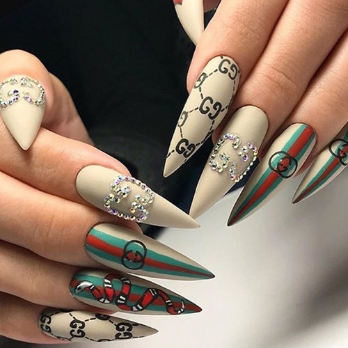 intricate Gucci nail design