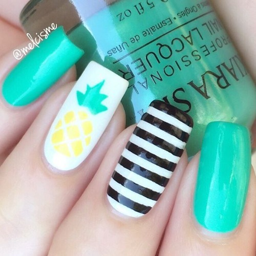 turquoise pineapple nails with black stripes