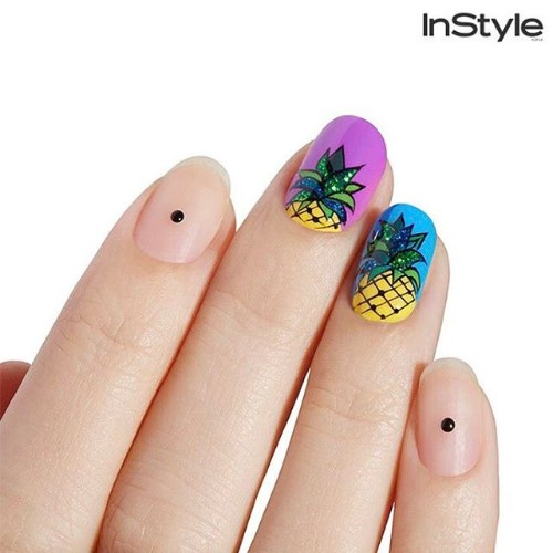 two bright accent nails with pineapples