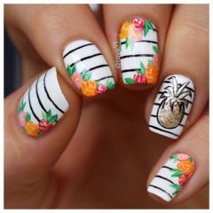 white and black nails with glitter pineapple and orange flowers