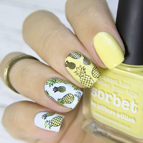 white and yellow nails with stamping pineapples