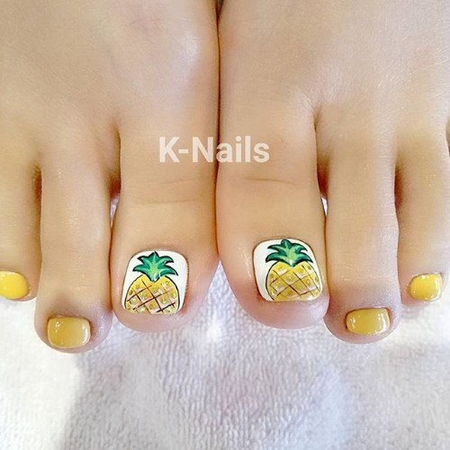 white pedicure with a pineapple