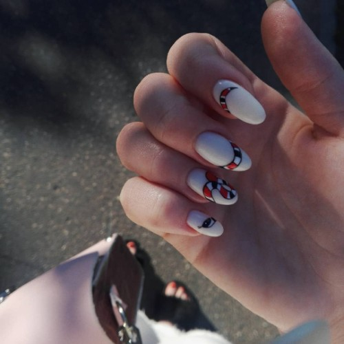 white nail art with a snake