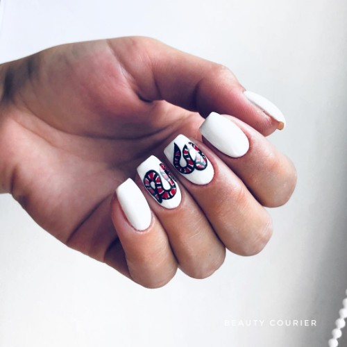 white Gucci manicure with snake