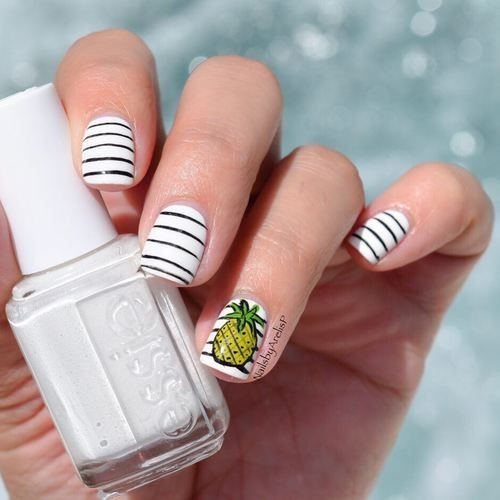 white nail design with black  stripes and pineapple