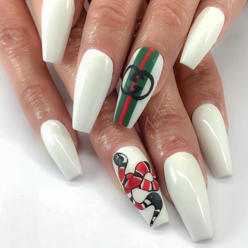 white Gucci manicure with a snake and branded Gucci stripes