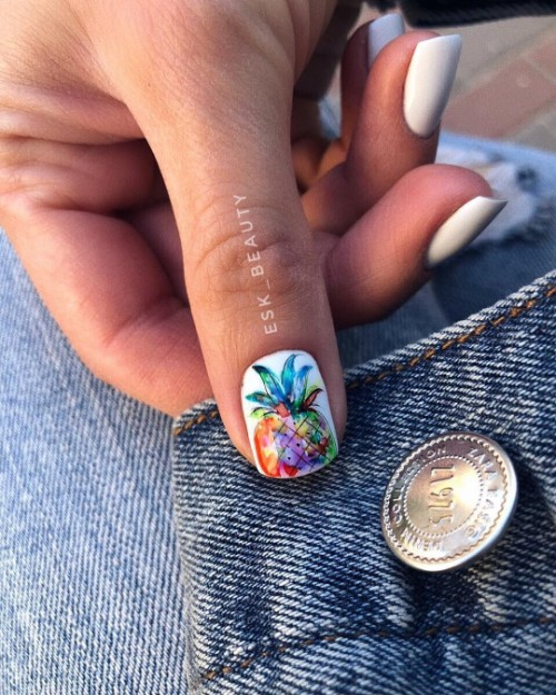 white mani with accent pineapple nail