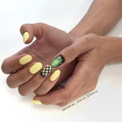 yellow and black nail art with pineapples