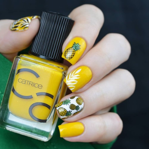 yellow pina colada nail design with pineapples