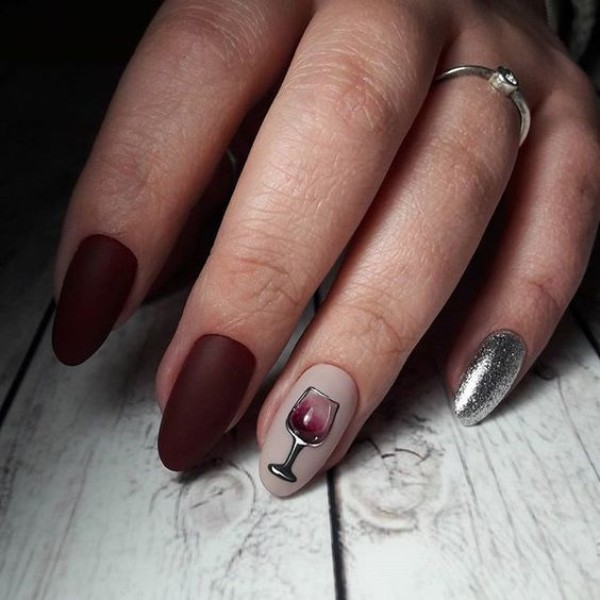 wine-manicure-with-accent-glitter-nails