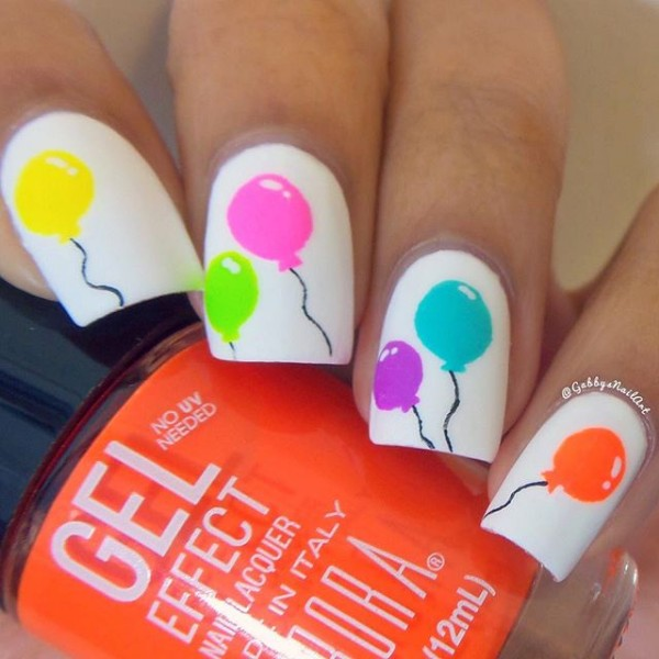 Nail Art With Balloons On A White Base