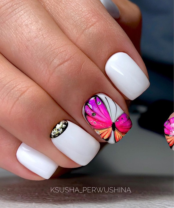 white nails with bright pik butterfly design