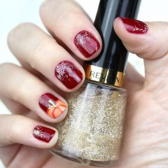 burgundy-pumpkin-nail-design