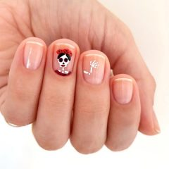 frida-kahlo-skeleton-halloween-nail-design