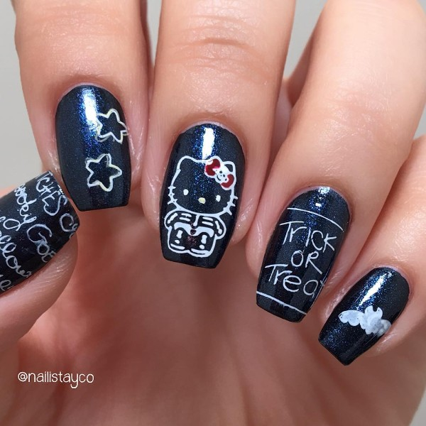hello-kitty-skeleton-nail-design-halloween