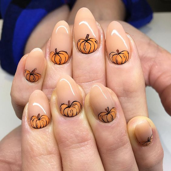 nude-nails-with-orange-pumpkins