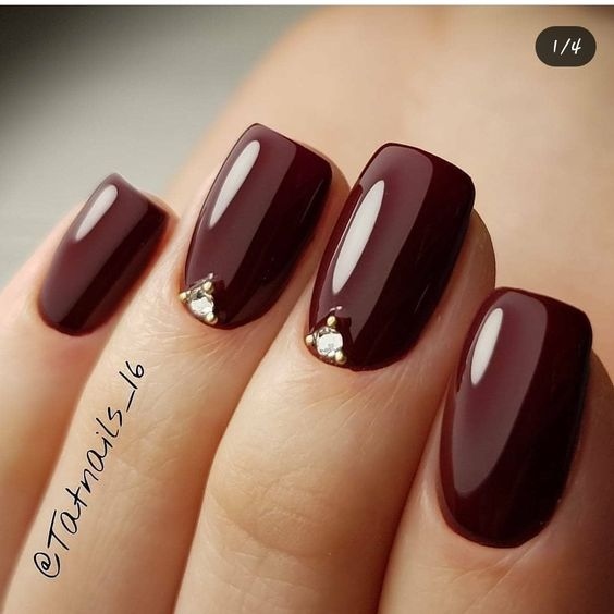 Glossy burgundy nails with rhinestones: @tatnails_16