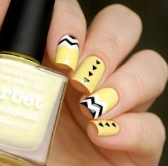 black and yellow geometric nail art