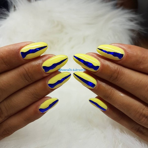 dark blue and yellow nails