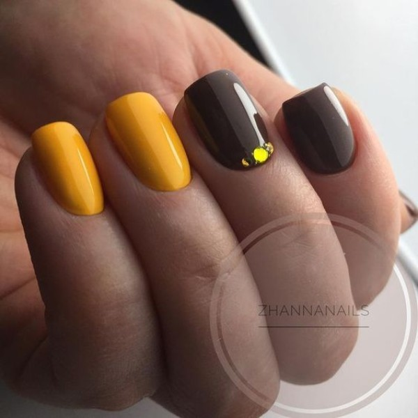 yellow and brown manicure with stones
