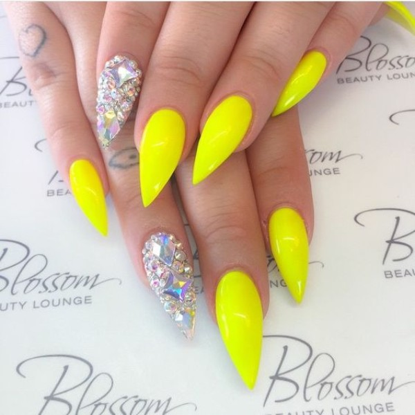 long yellow stiletto manicure