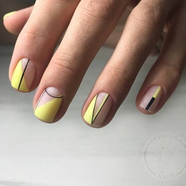 matte pastel yellow manicure with black lines