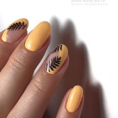 orangy yellow nails with leaves design
