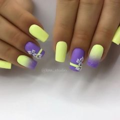lily and yellow nail art with ombre
