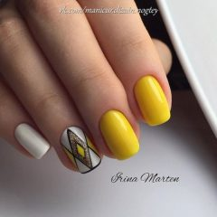 yellow and white nail art with black geometric lines