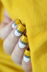 white n yellow nails with geometric design