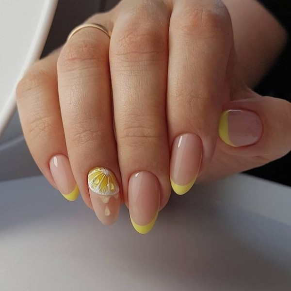 perfect oval shaped nails with french tips and lemon drawing