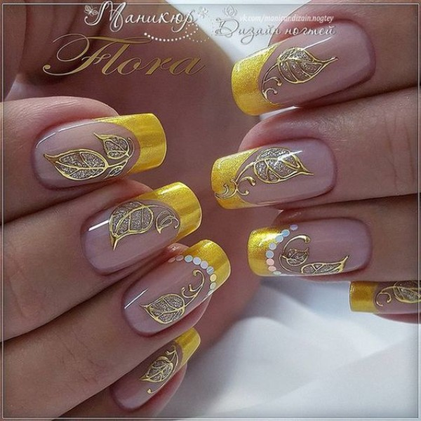 yellow french mani with golden leaves