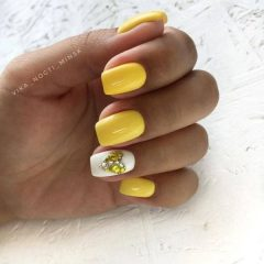 yellow and white nails with a rhinestones heart