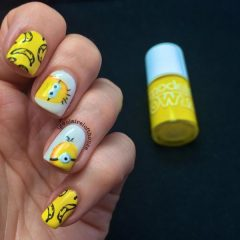 yellow minion nail design