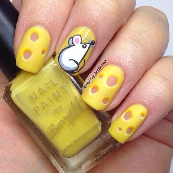 yellow nails with cheese and a mouse
