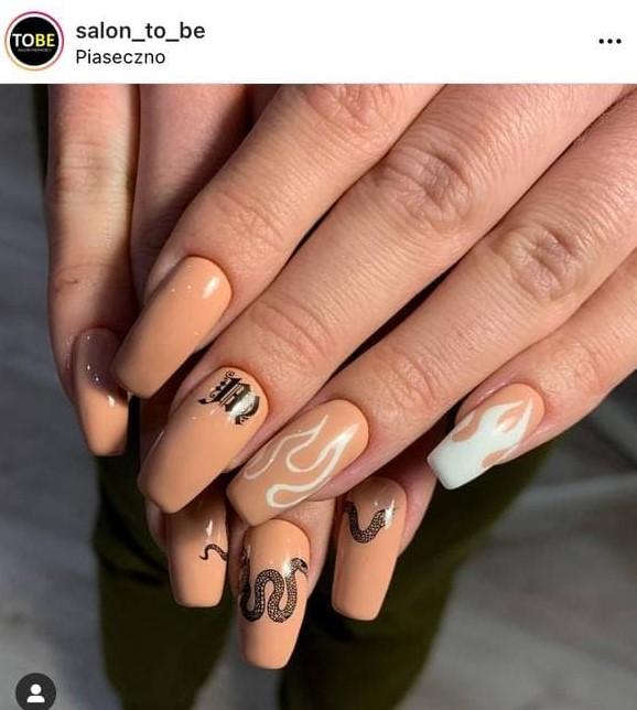 Manicure with a Beige Nail Polish and Tattoo-Like Flames and a Snake