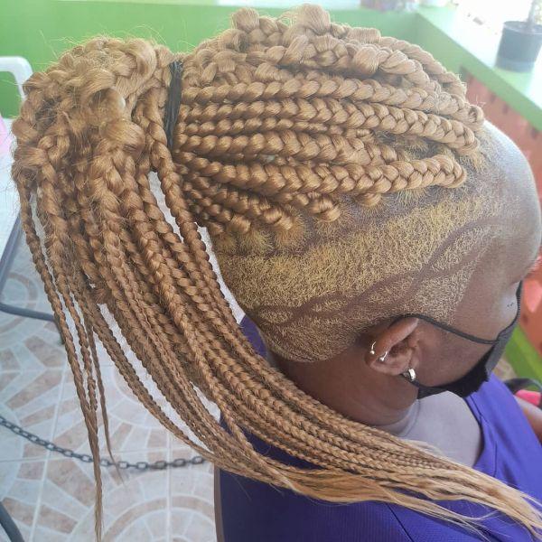 Long Blonde Jungle Braids and Undercut Sides